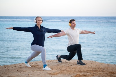Young couple working out outdoor with music