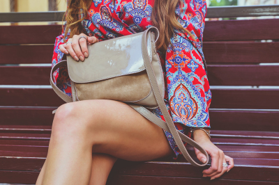 Girl in red dress with beige leather handbag