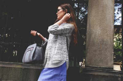 Stylish girl in sweater
