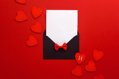 Envelope Mail, Heart and Ribbon on red Background. Valentine Day Card, Love or Wedding Greeting Concept. Top view
