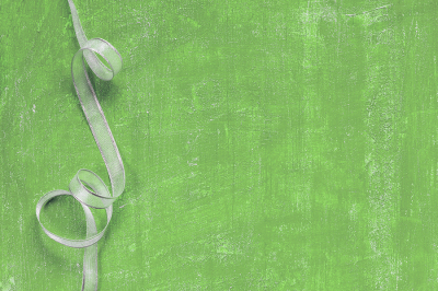 Silver ribbon on the green background