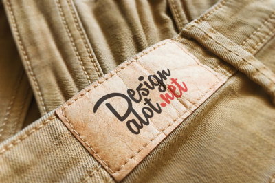 Beige Paper Label on Yellow Jeans