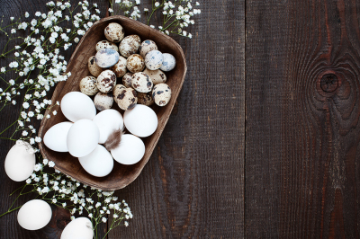 Wooden background with eggs