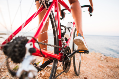 Closeup of cyclist woman legs riding bike on outdoor trail