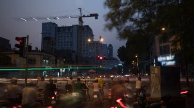 Transport on the roads of evening Hanoi, Vietnam