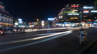 Night city street with transport in motion. Hanoi, Vietnam