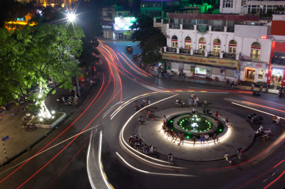 Night traffic on the square with motion trails. Hanoi, Vietnam