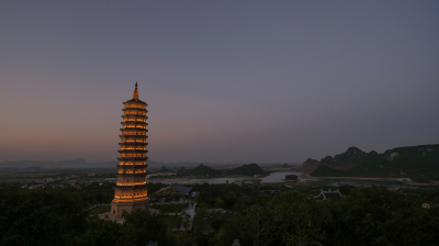 Bai Dinh Temple with illuminated tower in the dusk, Vietnam