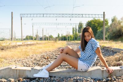 Teenager girl in city outskirts