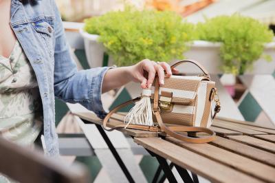 Woman with tiny handbag