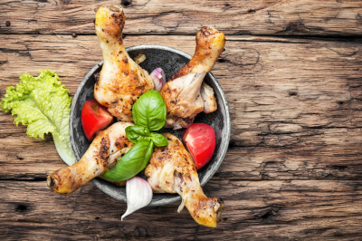 Roasted chicken legs and salad with fresh vegetables