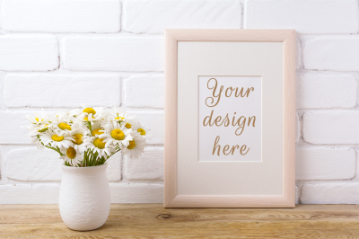 Wooden frame mockup with chamomile bouquet in rustic vase.