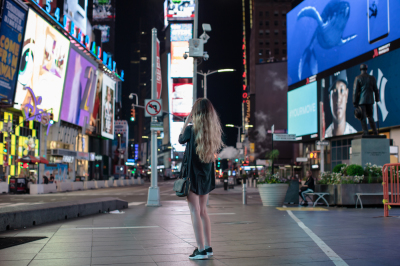 Girl taking photos in time square
