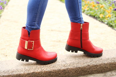 Legs in red leather boots