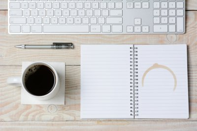 White Desk With Coffee and Keyboard