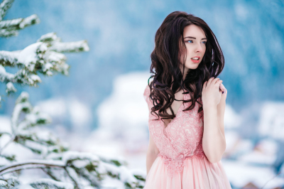 Photo set from 28 photos.Girl with blue eyes on the background of snow mountains.