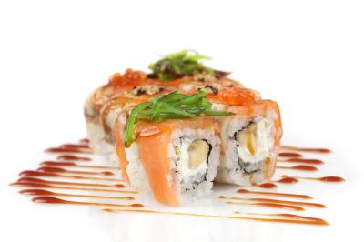Sushi rolls with banana, salmon, eel fish, wakame seaweed, red caviar on white