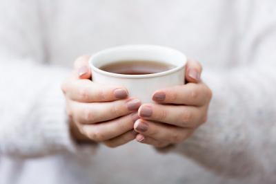 Woman Cupping Herbal Tea Mug
