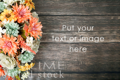 Fall flowers on a wood background
