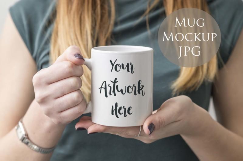 Free Woman holding blank mug mockup (PSD Mockups)