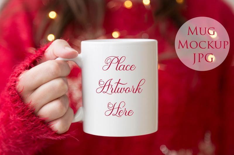 Free Woman holding mug-red chrismas (PSD Mockups)