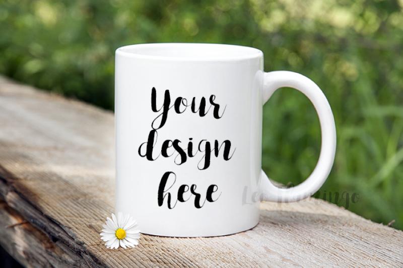 Free White Coffee 11oz mug mockup bokeh nature template for design (PSD Mockups)