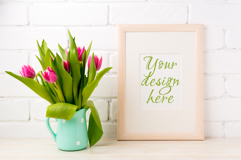 Free Wooden frame mockup with bright pink tulips (PSD Mockups)