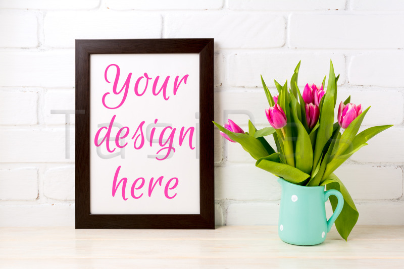 Free Black brown frame mockup with bright pink tulips bouquet (PSD Mockups)