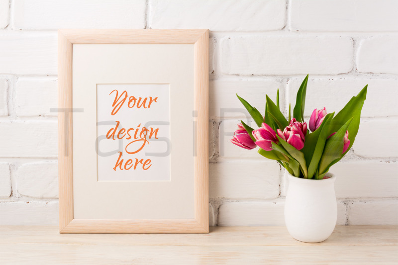 Free Wooden frame mockup with magenta pink tulips bouquet (PSD Mockups)