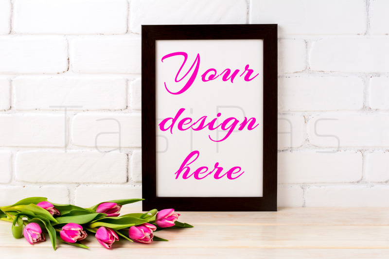 Free Black brown frame mockup with rich magenta pink tulips bouquet (PSD Mockups)