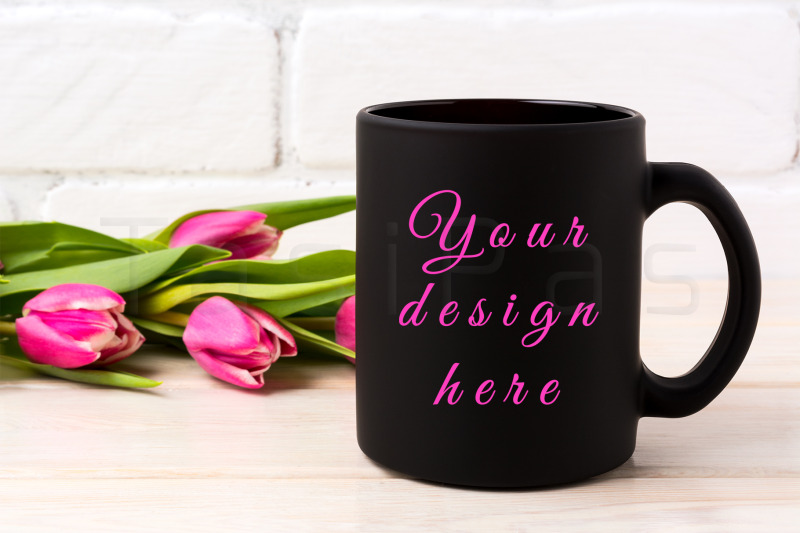 Free Black coffee mug mockup with rich magenta pink tulips bouquet (PSD Mockups)