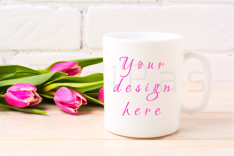 Free White coffee mug mockup with rich magenta pink tulips bouquet (PSD Mockups)