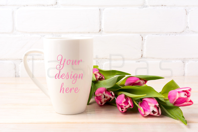 Free White coffee latte mug mockup with bright pink tulips bouquet (PSD Mockups)