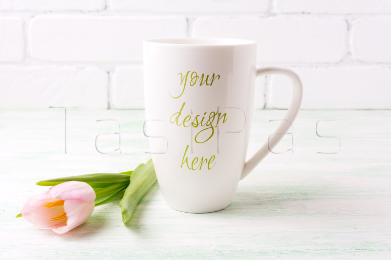 Free White coffee cappuccino mug mockup with tender pink tulip flower. (PSD Mockups)