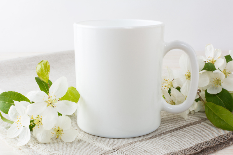 white-coffee-mug-mockup-with-blossoming-apple-tree-branch