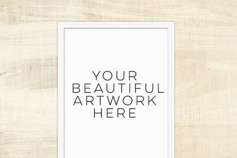 Free White Frame Mockup with Wood Background, Mock up Frame, empty frame, empty photo frame, instant Download, Poster Mockup, art print mock up (PSD Mockups)