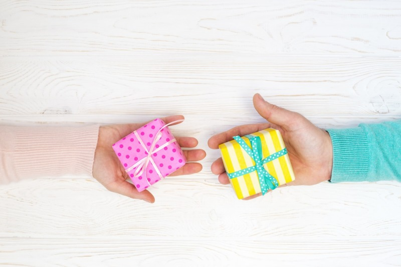 gift-boxes-in-woman-s-and-man-s-hands