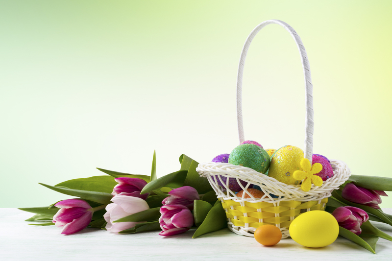 happy-easter-elegant-background-with-painted-eggs-in-yellow-basket