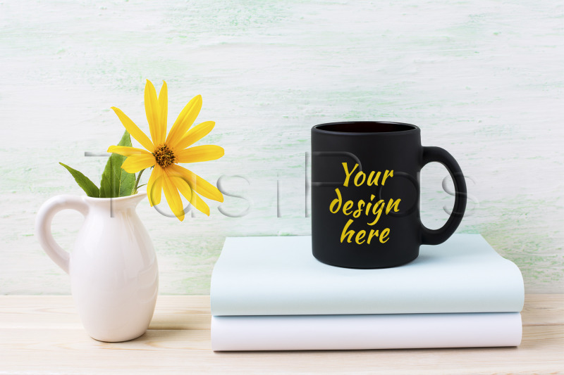 black-coffee-mug-mockup-with-yellow-rosinweed-flowers-in-pitcher