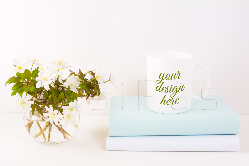 Free White mug mockup with Rue Anemone flowers. (PSD Mockups)
