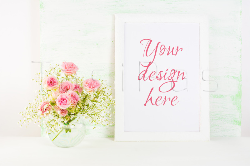 Free White frame mockup with pink rose flowers. (PSD Mockups)