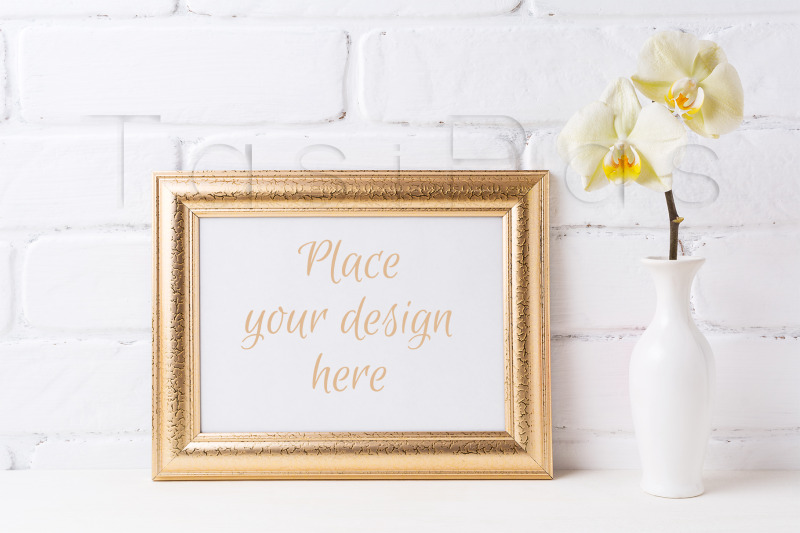 Free Golden  landscape frame mockup with soft yellow orchid in vase. (PSD Mockups)