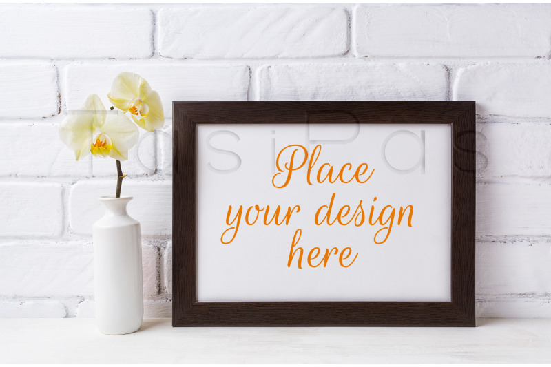 Free Black brown  landscape frame mockup with soft yellow orchid in vase.  (PSD Mockups)
