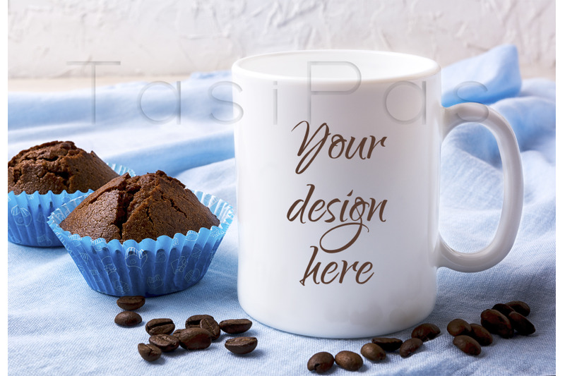 Free White mug mockup with coffee beans and two chocolate muffins (PSD Mockups)
