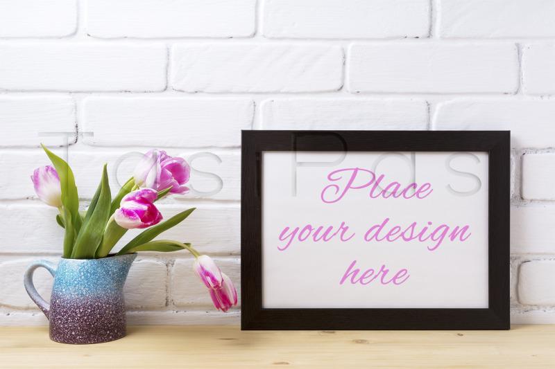 Free Black brown landscape frame mockup with pink tulip in purple blue vas (PSD Mockups)