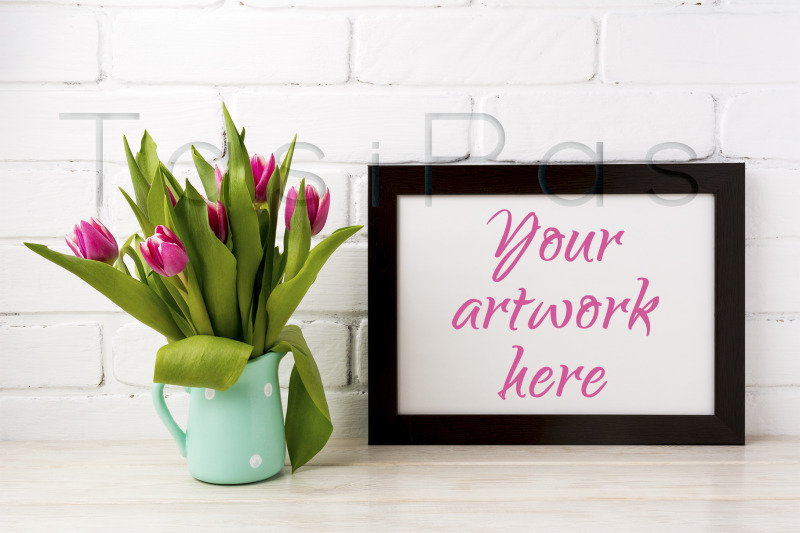 Free Black brown landscape frame mockup with magenta tulips in mint green (PSD Mockups)