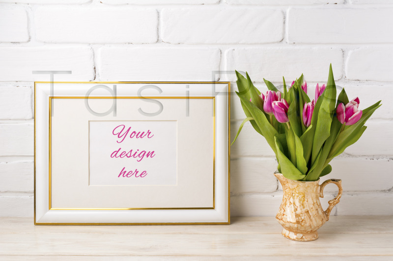 Free Gold decorated landscape frame mockup with bright pink tulips in golde (PSD Mockups)