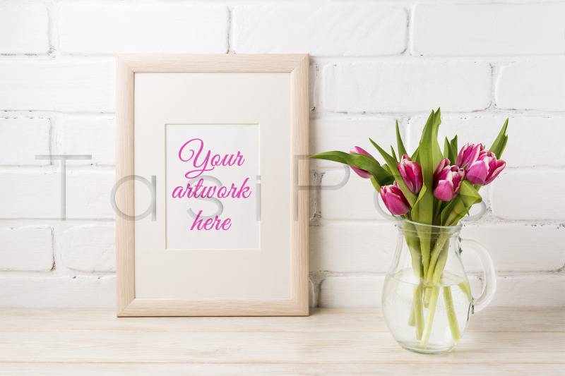 Free Wooden frame mockup with magenta pink tulips in glass pitcher jar. (PSD Mockups)