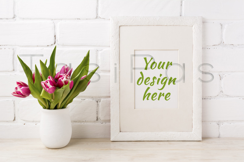 Free White frame mockup with magenta pink tulip in the flower pot. (PSD Mockups)
