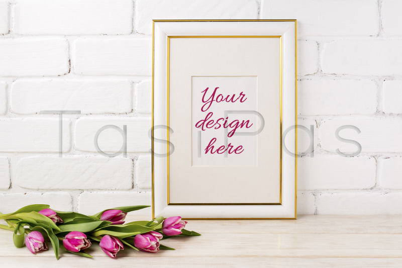 Free Gold decorated frame mockup with magenta tulips bouquet. (PSD Mockups)